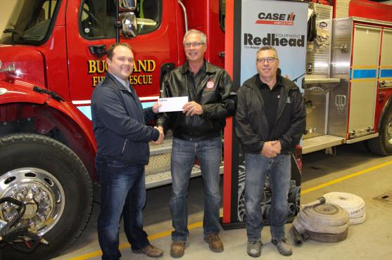Cheque presentation for the Field of the Future donation. (L to R) Arron McLean (Sales Manager, Redhead Equipment), Leonard Yungwirth (Chairman, Buckland Fire & Rescue), Ward Howat (Deputy Fire Chief, Buckland Fire & Rescue).